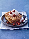 Waffles with wild strawberries and ice cream