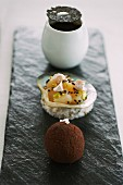 An elegant appetiser plater with various types of truffles