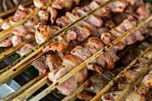 Som moo (grilled fermented pork skewers) in Vientiane, Laos