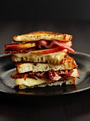 Toasted bacon, apple and cheese sandwiches