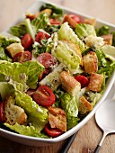 Caesar salad with tomatoes and croutons