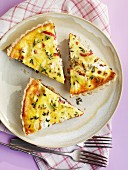 Three slices of herb quiche with bacon