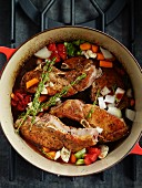 Pork chops with vegetables in a braising dish