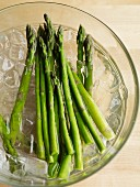Green asparagus in iced water