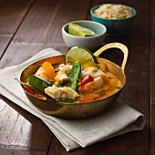 Fish curry with colourful vegetables and coconut