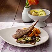Lamb chop with herb potatoes and a pumpkin medley