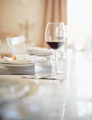 A Thanksgiving place setting with a glass of water and a glass of red wine