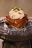 Kulfi ice cream with pistachios and rosewater on waffles
