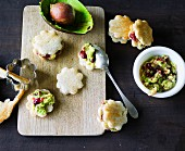 Cut out bread canapés with avocado cream