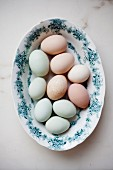 A plate of different coloured eggs