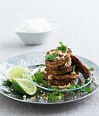 Mini omelettes with lime, coriander and macadamia nuts