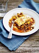 Vegetable and lentil stew with fried feta cheese