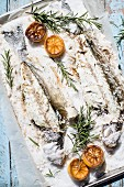 Bass with a salt crust, lemons and rosemary