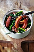 Green kale with Pinkel (smoked sausage from bacon, groats and spices) in a pot