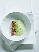 Foamy cress soup with langoustine