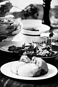 Mixed leaf salad on a laid table (black and white image)