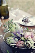 Artichokes as table decoration for a Provençal meal in a garden