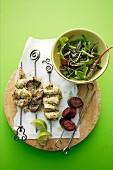 Churrasco skewers with salad