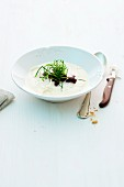 Creamy soup with horseradish, beetroot and fried leek greens