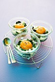 Eggs in jars with spinach