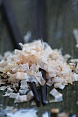 Dried bonito flakes on chopsticks