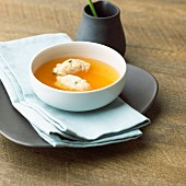 Tomato consomme with basil dumplings