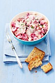Herring salad with beetroot, apple, red onions and mayonnaise