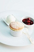 Banana souffle with ice cream and cherry sauce