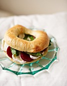 Bagel filled with beetroot and soft cheese for an autumnal breakfast
