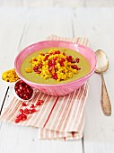 Pea and coconut milk soup with millet and pomegranate seeds