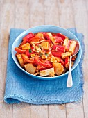 Surimi with garlic, pepper and pineapple in a tomato sauce