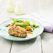 Chicken breast fillet with a sesame seed coating with a delicate leek medley