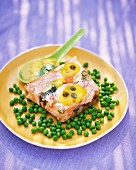 Salmon terrine on a bed of peas with a caper sauce