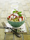 White cabbage salad with radishes and goat's cream cheese