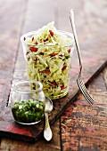 White cabbage salad in a jar with goji berries