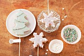 Christmas tree and snowflake-shaped biscuits on sticks