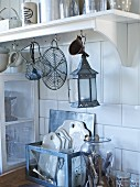 Various vintage kitchen utensils in white kitchen