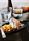 A salmon steak on a carrot salad