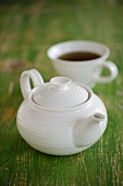 A teapot and a cup of tea