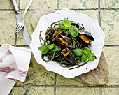 Herb pasta with mussels and basil