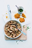 Turkey with mushrooms and carrot and sweetcorn cakes