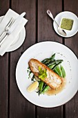 Hake on a bed of green vegetables