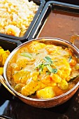 Navratan korma with curried potatoes, rice and lentils
