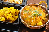 Navratan Korma with curried potatoes, rice, and lentils (India)