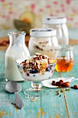 Crispy muesli with yogurt, almonds and summer fruits