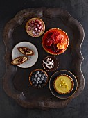 Various fruit tarts on a metal tray