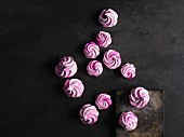 Pink meringues on grey surface