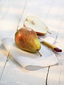 Pears on a cloth with a knife
