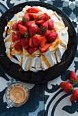 Pavlova with strawberries and caramel sauce