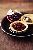 Chocolate pudding with pomegranate seeds